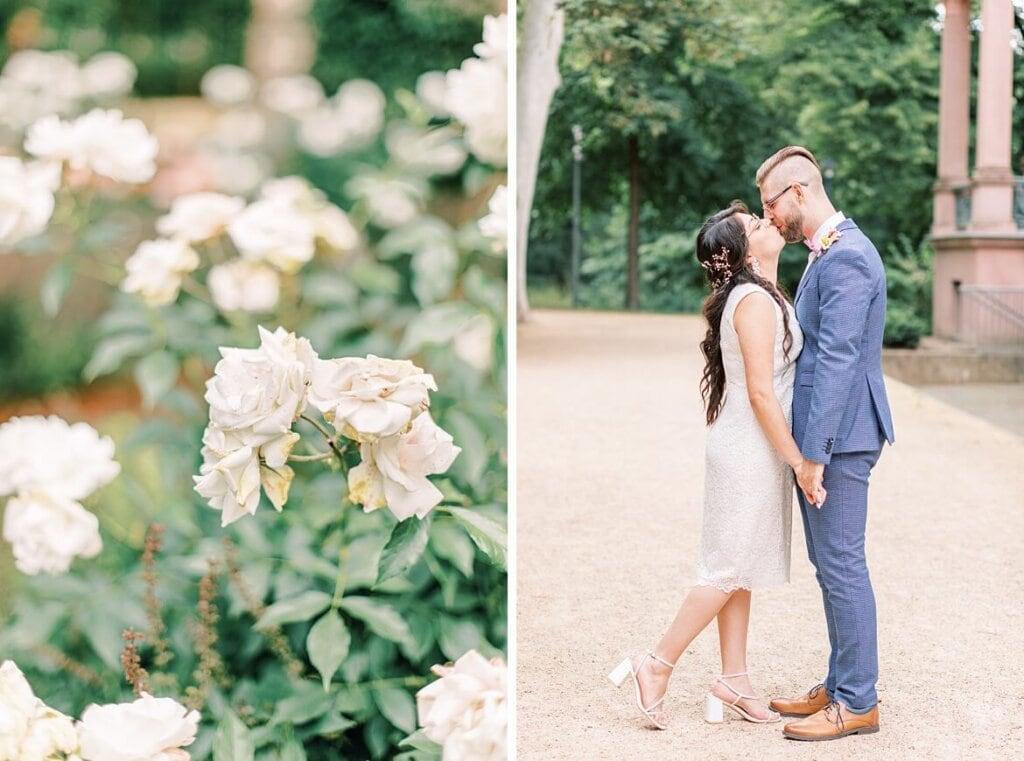Brautpaar küsst sich und Rosen