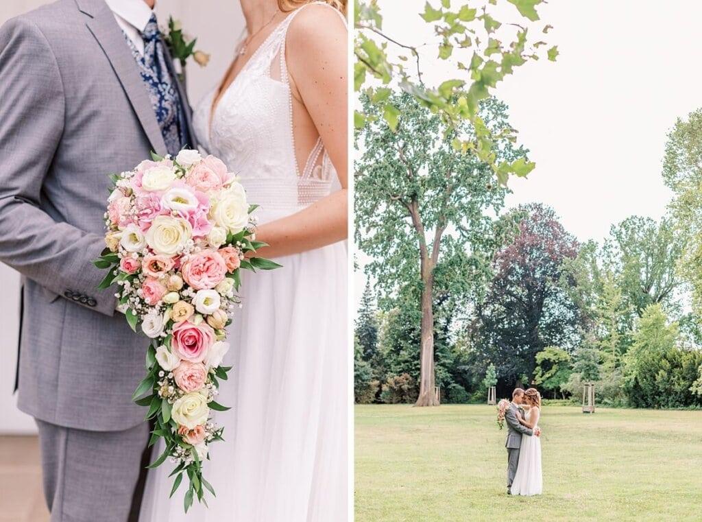 Brautstrauß und Brautpaar im Park
