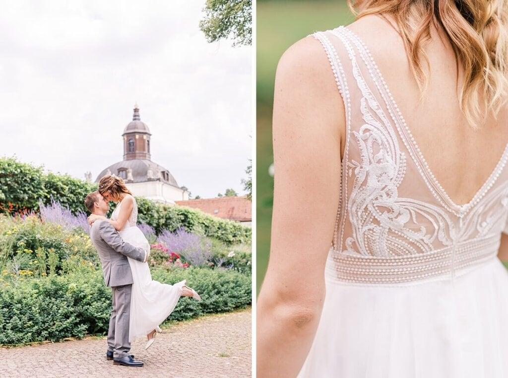 Bräutigam hebt Braut und Ansicht vom Kleid