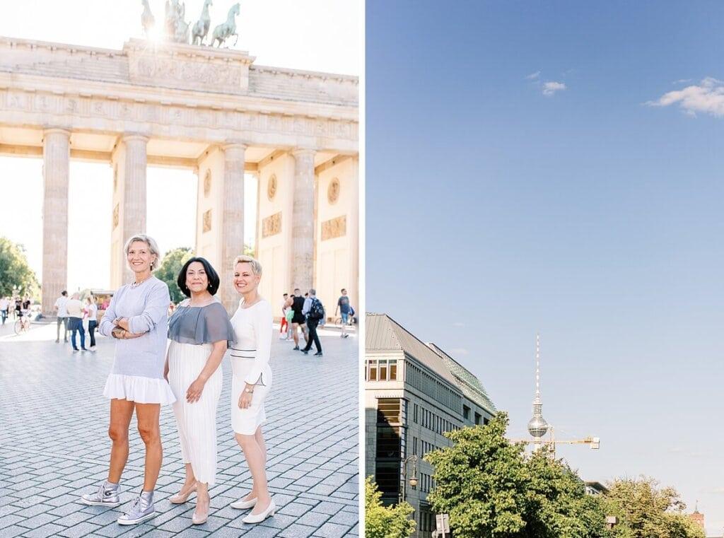 Portrait von drei Frauen vor dem Brandenburger Tor Berlin und im Hintergrund der Fernsehturm