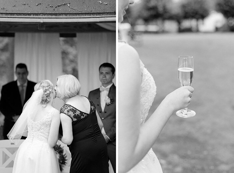 Brautmutter übergibt Braut, Nahaufnahme von Sekt