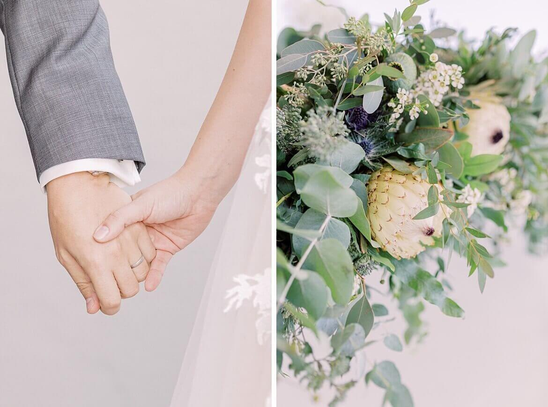 Nahaufnahme von Händen und Blumen