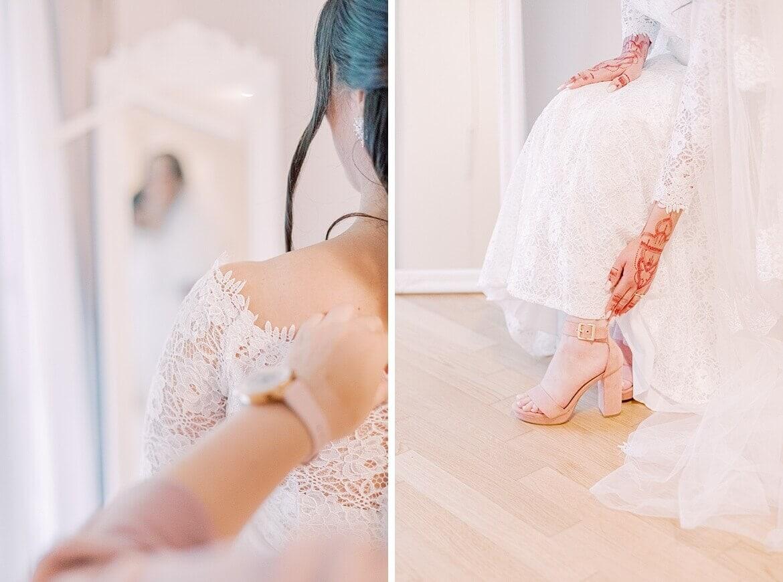 Braut beim Anziehen