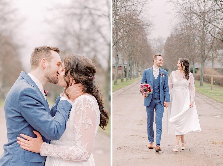 Brautpaar im Winter küsst sich