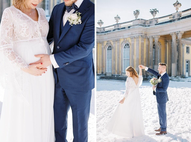 Brautpaar im Schnee und mit Babybauch