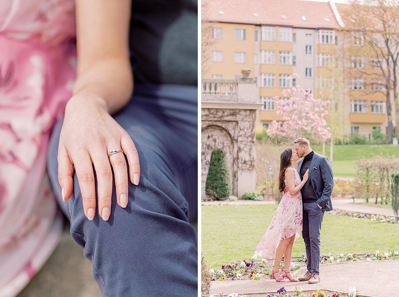 Verlobungsring und Paar küsst sich im Park